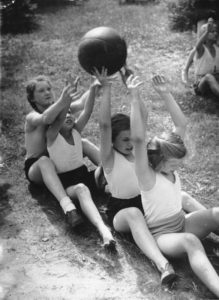 four girls playing with a ball