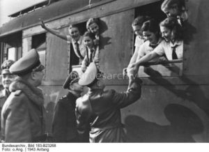 Children on a train saying good-bye to their parents