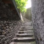 ascending stairs and stone walls