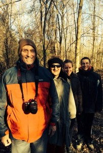 Family posing in the woods