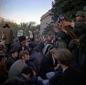 people protesting the Vietnam war with soldiers standing in front of them