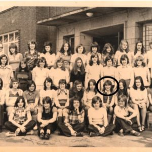 class photo in front of high school
