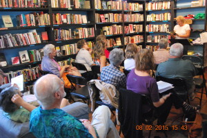 Annette Oppenlander reading in front of a group in a bookstore