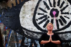 author annette oppenlander doing yoga outdoors