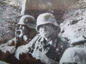 two men in German uniform in dugout