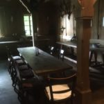 old hall with table and chairs