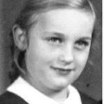 young girl smiles