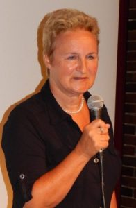 middle aged woman with microphone