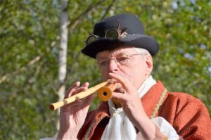 man playing with two recorders