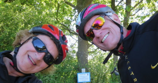 a couple wearing bike helmets and glasses