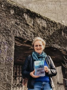 woman holding book in front of bunker